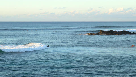Surfers surfing in Pacific Ocean at Easter Island Footage
