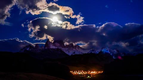 Fitz Roy the moon and El Chalten village at dawn Footage