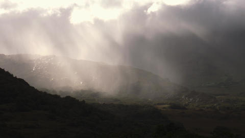 God sun rays trough clouds and fog in a valley Footage