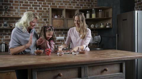 Joyful family awaiting to taste cookies in kitchen Footage