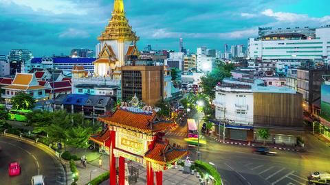 Twilight time lapse of traffic at Wat Trimitr in Bangkok Footage