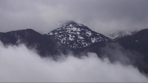 Top of mountain in snow and clouds in alps Footage