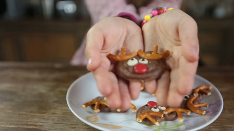 Child's hands offering delicious homemade cookie Footage