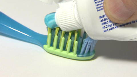 Serving toothpaste on the toothbrush Image