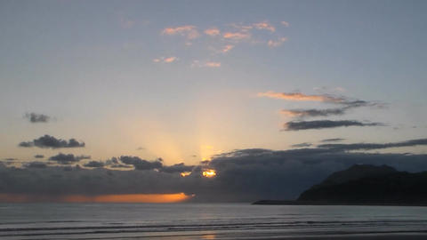Sunrise from Cantabria sea in cloudy weather. Timelapse.Accelerated.video Footage
