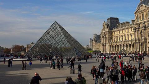 Louvre. The famous art museum in Paris. Pyramid. France Live Action