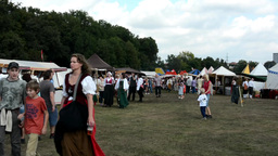 People walk on the exhibition - stalls with goods and food - ancient - ground an Footage