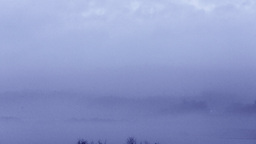 Clouds moving over the marsh river at mountain in rain day Footage