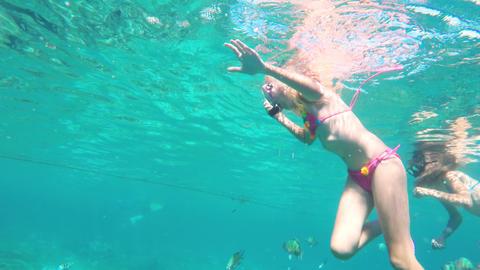 Young girl scuba diver Live Action