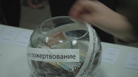 1080p Ungraded: Visitors Put Money in Glass Bowl With Russian Inscription Footage