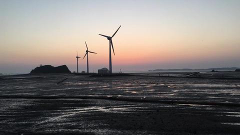 Wind turbines at sunset,Daebudo Island,South Korea Footage