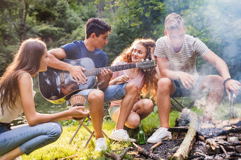 Teenagers camping in forest Photo
