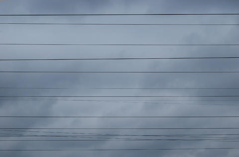 High-voltage wires against the background of a gloomy autumn sky Fotografía