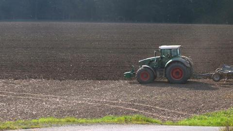 Farm tractor on field in autumn Footage
