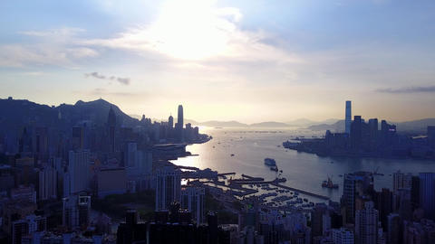 Silhouettes of buildings at Victoria Harbour shores, Hong Kong aerial shot Footage