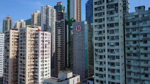POV fly to dense build residential area at Kennedy Town, Hong Kong Island Footage