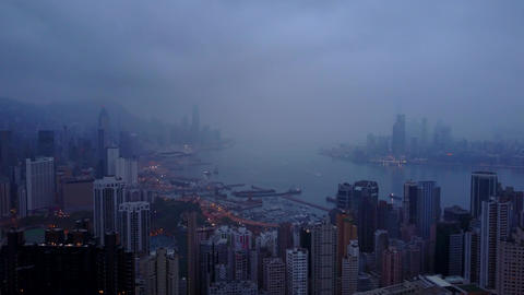Sleeping Hong Kong aerial cityscape at early morning, low cloudy sky Footage