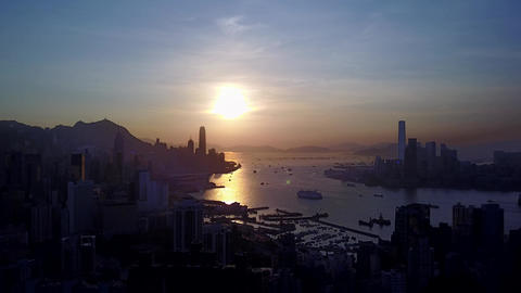 Hong Kong Island urban shore silhouetted aerial view against sunset Footage