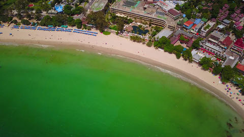Lush green water wash tropical beach, aerial high-angle shot Live Action