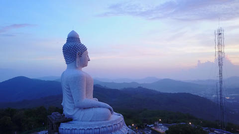 Buddha statue on top of mountain, side view, early morning time Footage