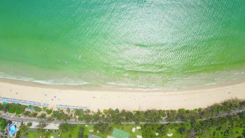 Amazing tropical sea with crystal water and clear beach, top-down aerial shot Live Action