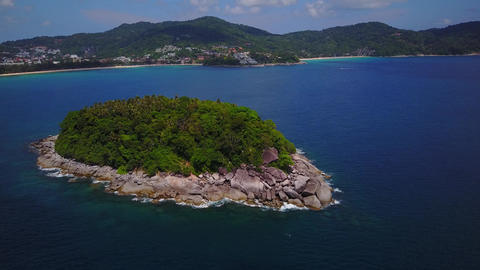 Nice green tropical island with rough rocky shore, aerial shot Footage