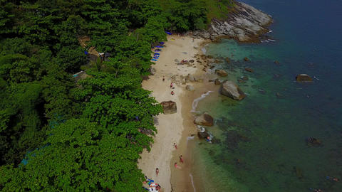 Exotic beach under green canopy of trees, large stones in... Stock Video Footage