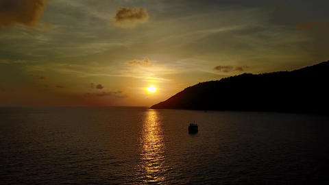 Beautiful sunset at Andaman sea, cape at southern area of Phuket Island, aerial Footage