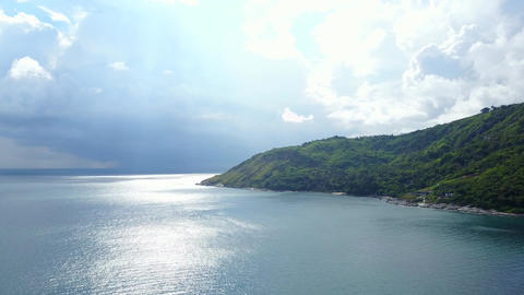 There is storm brewing over sea, sunny coast, heavy clouds hang over horizon Footage