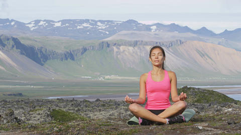 Yoga meditating woman in meditation in nature relaxing in serene harmony Footage