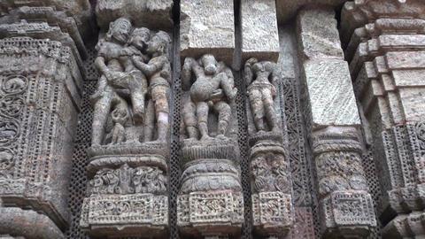 beautiful erotic sacred art sculptures on Konark sun temple wall, India Footage