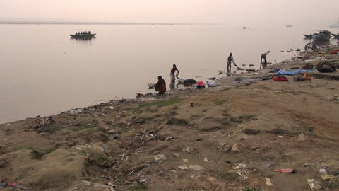 indian people workers washing clothes in sacred Ganges river water, Varanasi, Footage