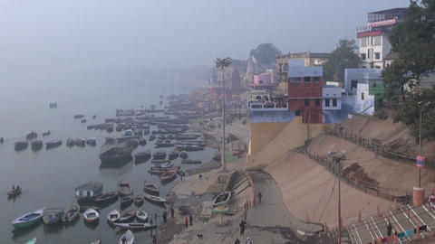 cold early morning fog and smog in sacred Ganges river with boats, Footage