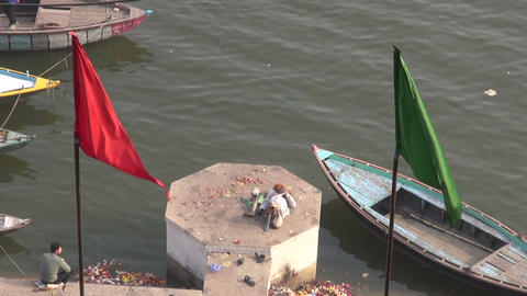 poor Indian handicapped invalid disabled beggar man on sacred Ganges river Footage