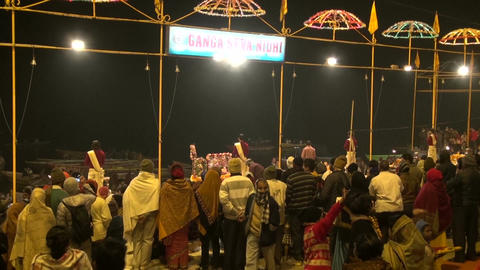 Night scene with religious praying ceremony by Ganges River in sacred city Footage
