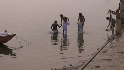 hindu brahmans morning ritual bath in sacred river Ganges water in Varanasi, Footage