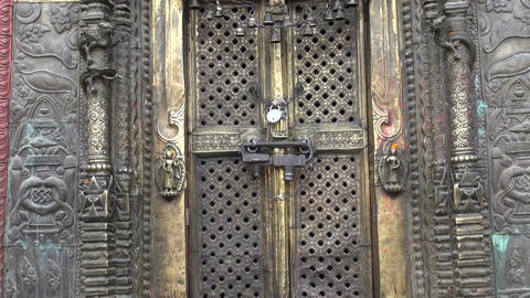 closed ornate temple in Katmandu historica door Filmmaterial