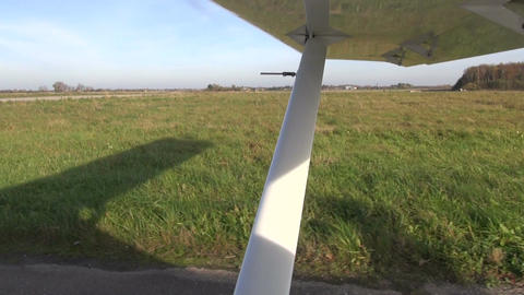 small airplane aircraft wing on rural airfield Live Action