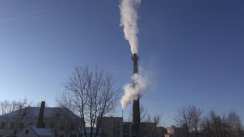 smoke on blue sky from industrial smokestack Footage