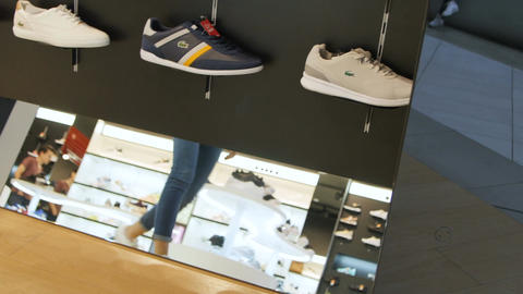 Closeup Girl Approaches Shoes Shelves Choosing White Trainers Footage