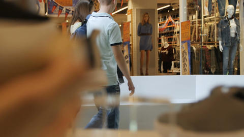 Macro Woman Holds Sneakers Couple Communicates in front of Shop Footage