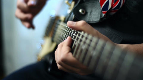 Guitarists Playing On Guitar Filmmaterial