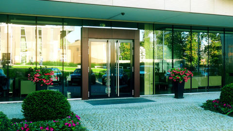 Modern office or residential building entrance reflecting street Footage