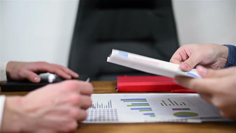 Businesspeople Checking Stock Exchange Etatistics Footage