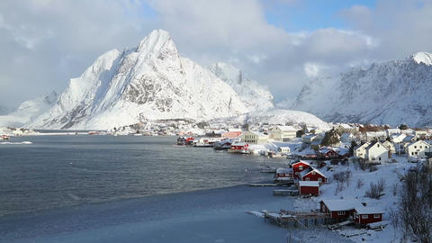 Norwegian fishing town on the background of winter mountains Footage