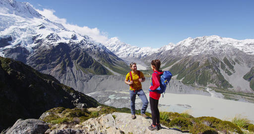 New Zealand hiking people enjoying view of Mount Cook on alpine hike Live Action