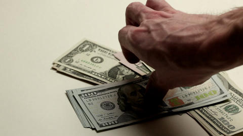 Hand putting dollar bills Footage