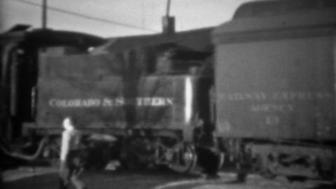 1936: Colorado southern railroad pulling away from train station Footage