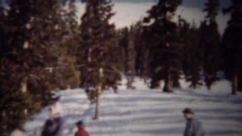 1940: Winter snow skiing T-bar chairlift ride up mountain Footage