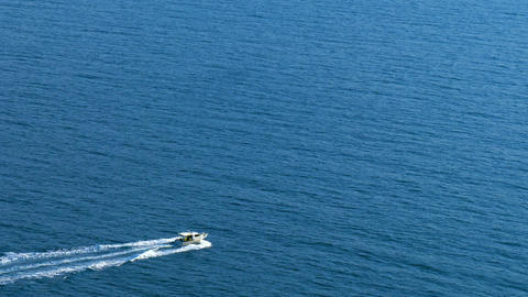 Boat moves on the sea, aerial view ビデオ
